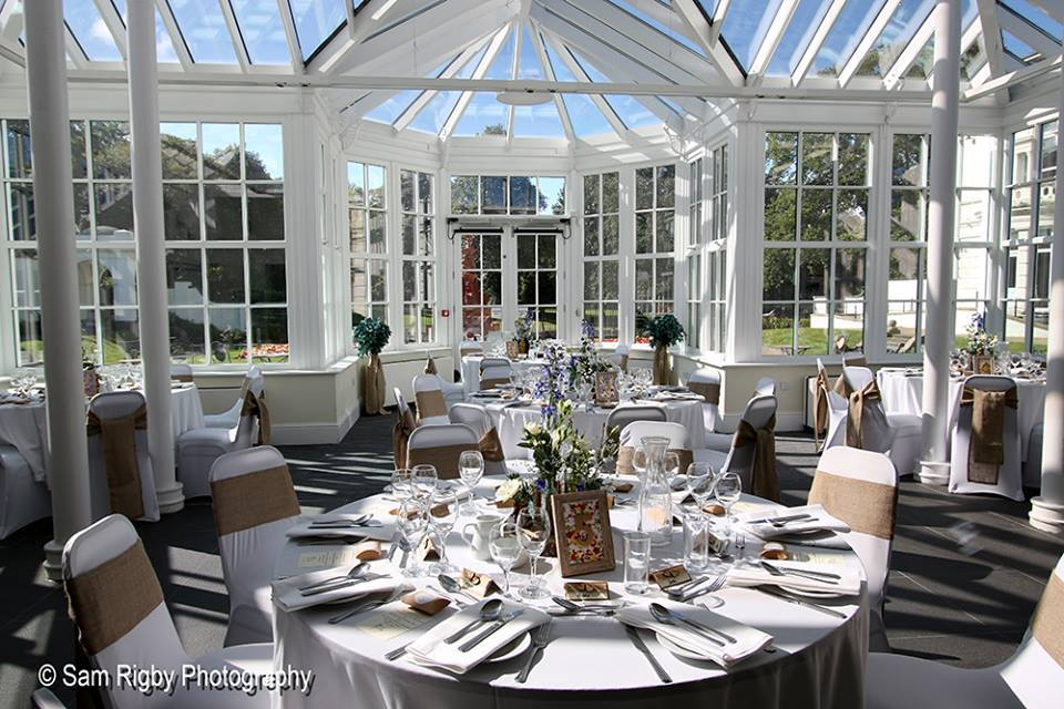 Orangery with tables set for an event
