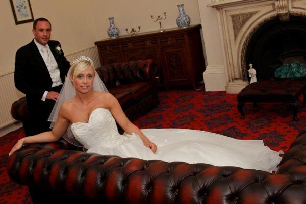 Wedding couple on the leather sofas in the Mansion House