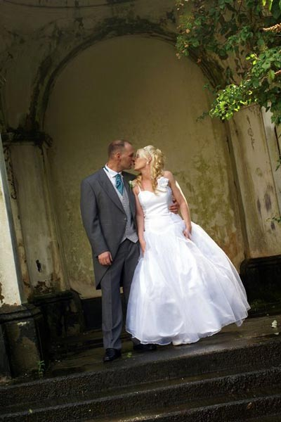 Wedding couple kissing in the Mansion House walled garden